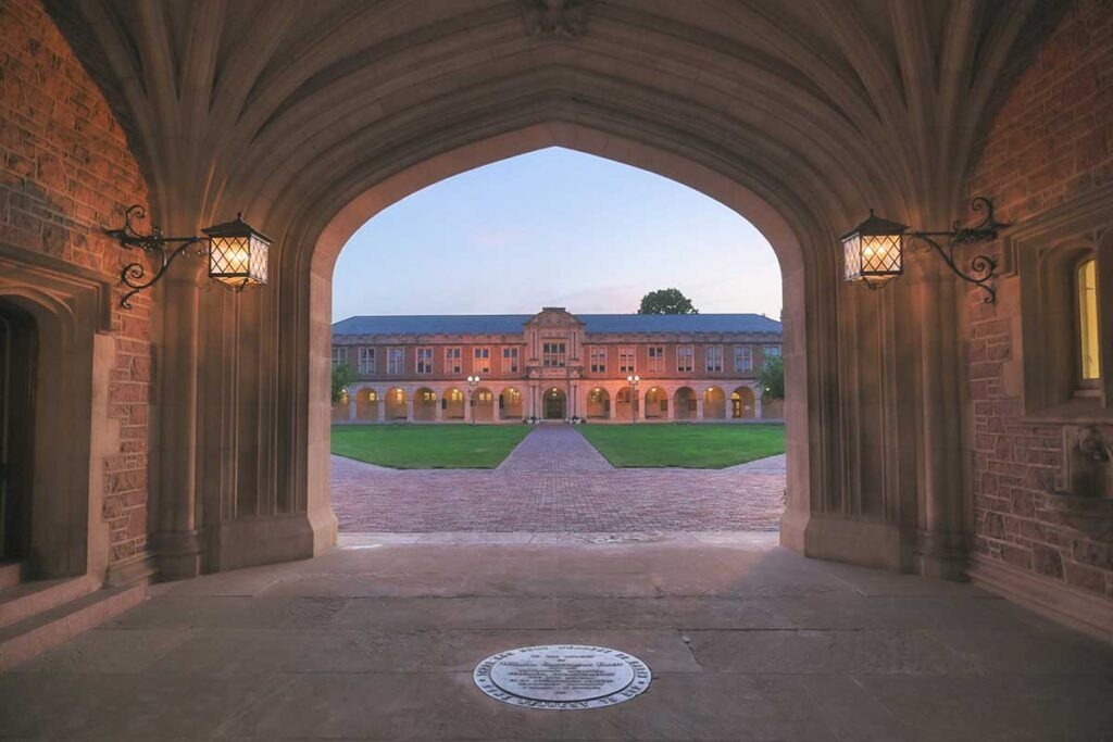 Photo shot through gothic stone archway on WashU's Danforth Campus